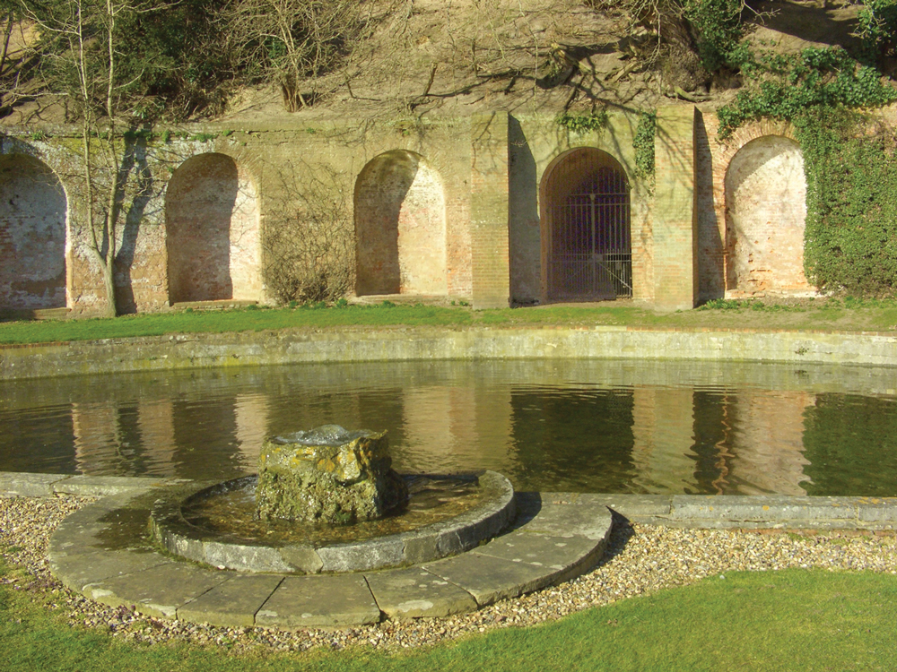 The exedra with semi-circular pool and fountain, showing the tunnel (crypta) through the hillside
