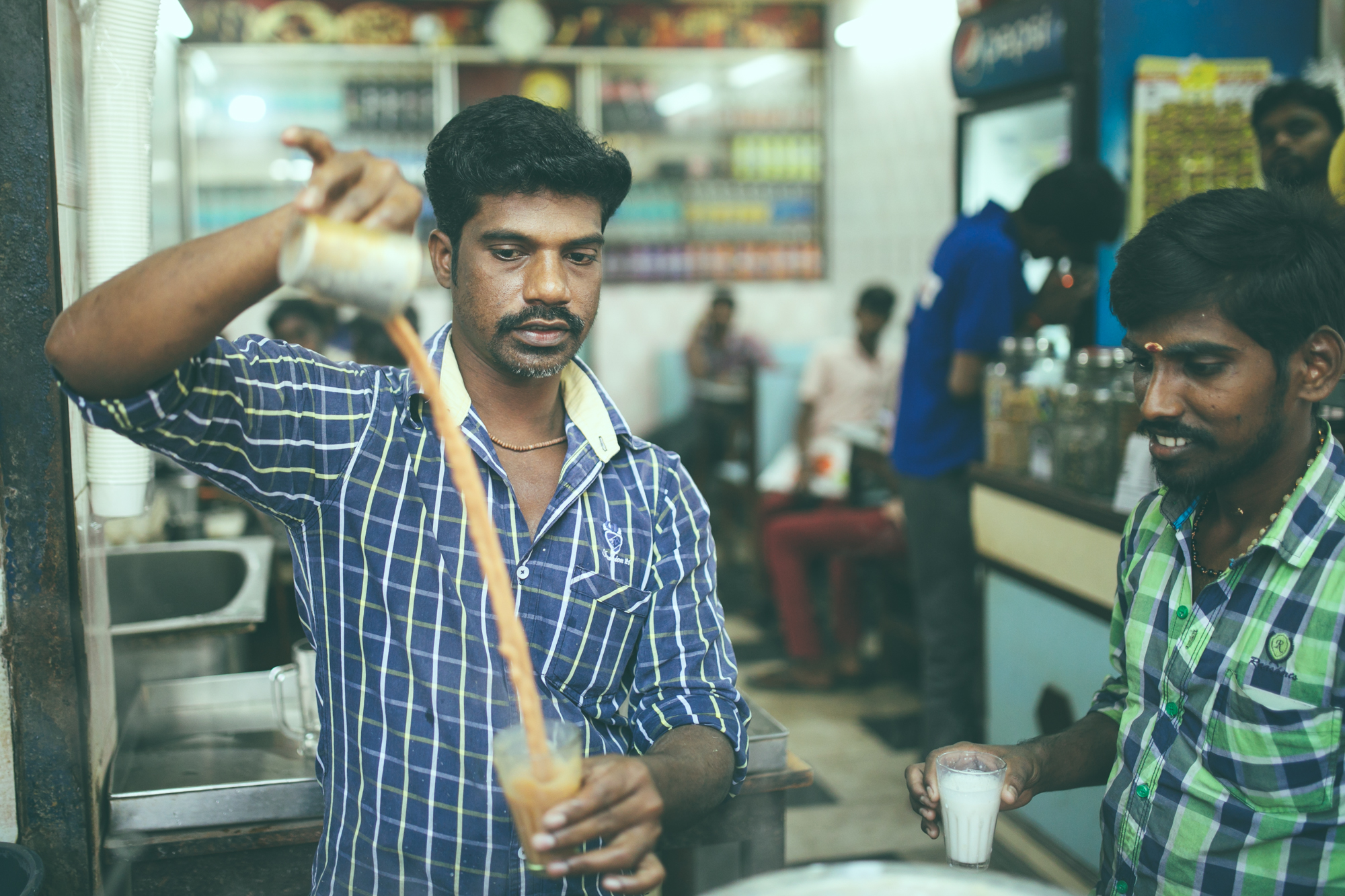 Chennai,  Vinay Aravind . The teashops in Thiruvanmiyur open around 5 am and stay open late into night, often beyond midnight. There's always tea and milk simmering on the stove. The chap who does the pouring ends with a flick of his wrist, leaving a long trail of tea suspended in the air for one glorious, theatrical moment. A tea costs Rs. 8, a special tea is Rs. 10.
