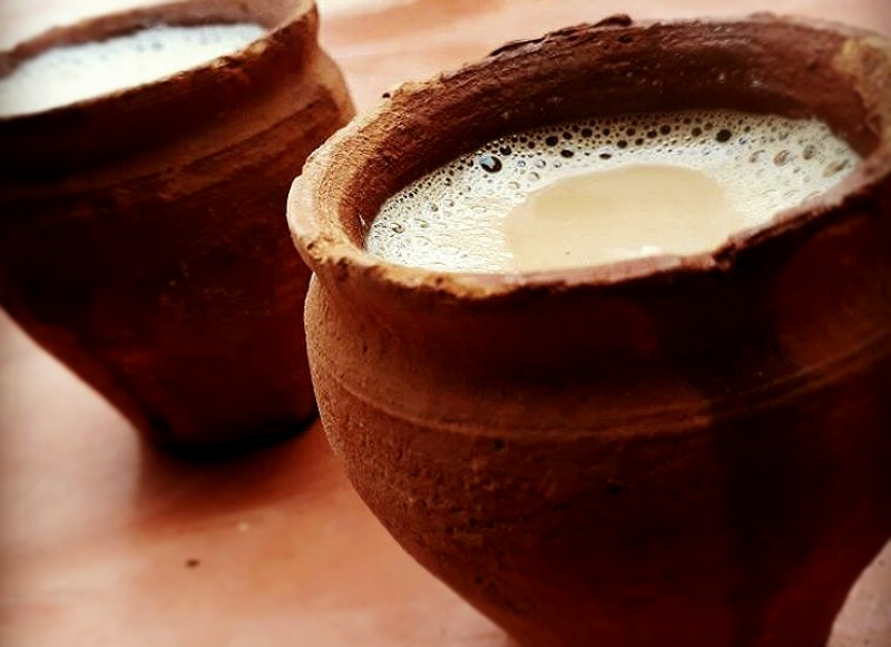 Maati bhaarer cha – Calcutta's famous matka chai. The miniature pink clay pots lend their own signature earthy flavour to the malty tea with its warming spices, creamy milk and generous dose of sugar.