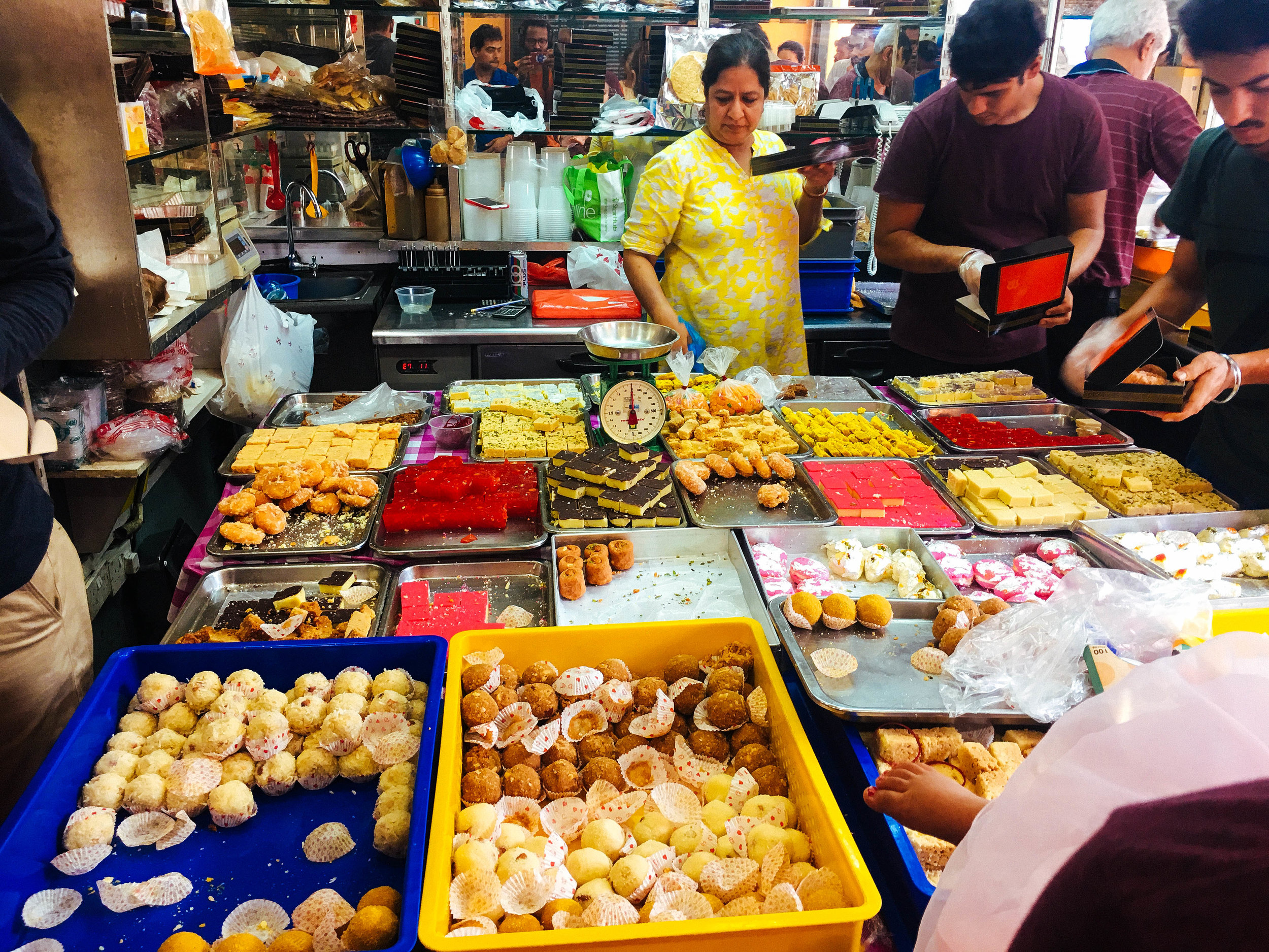 Buying sweets for Deepavali celebrations in Little India, Singapore