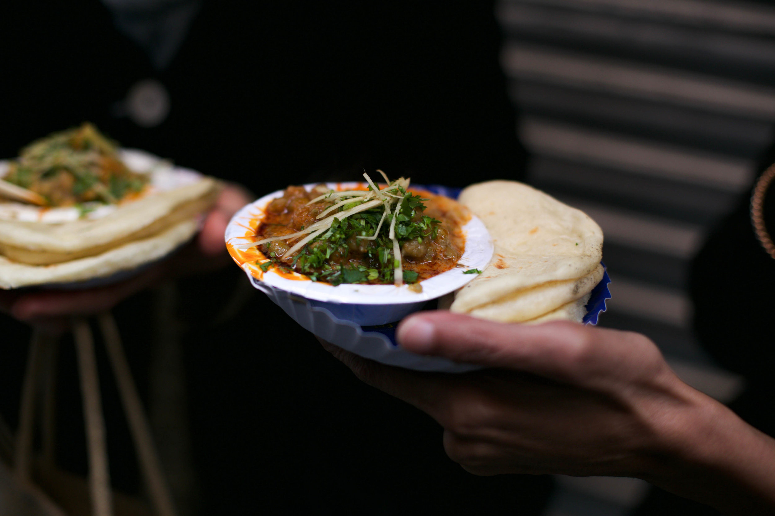 We stop for soft, warm kulchas paired with chole masala, a quintessentially Delhi dish. You can also have a glass of warm, spiced chickpea broth instead —equally delicious and full of 'takat' to survive the Delhi winter.