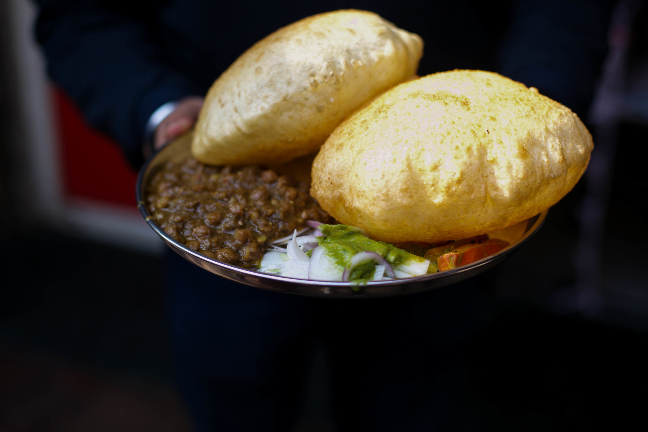 By the end of the walk we have eaten at 12 places, loosened our belts considerably, and are opting to walk instead of hopping into a rickshaw so we can make a bit more room. This chole bhature was hot, spicy and definitely worth it.