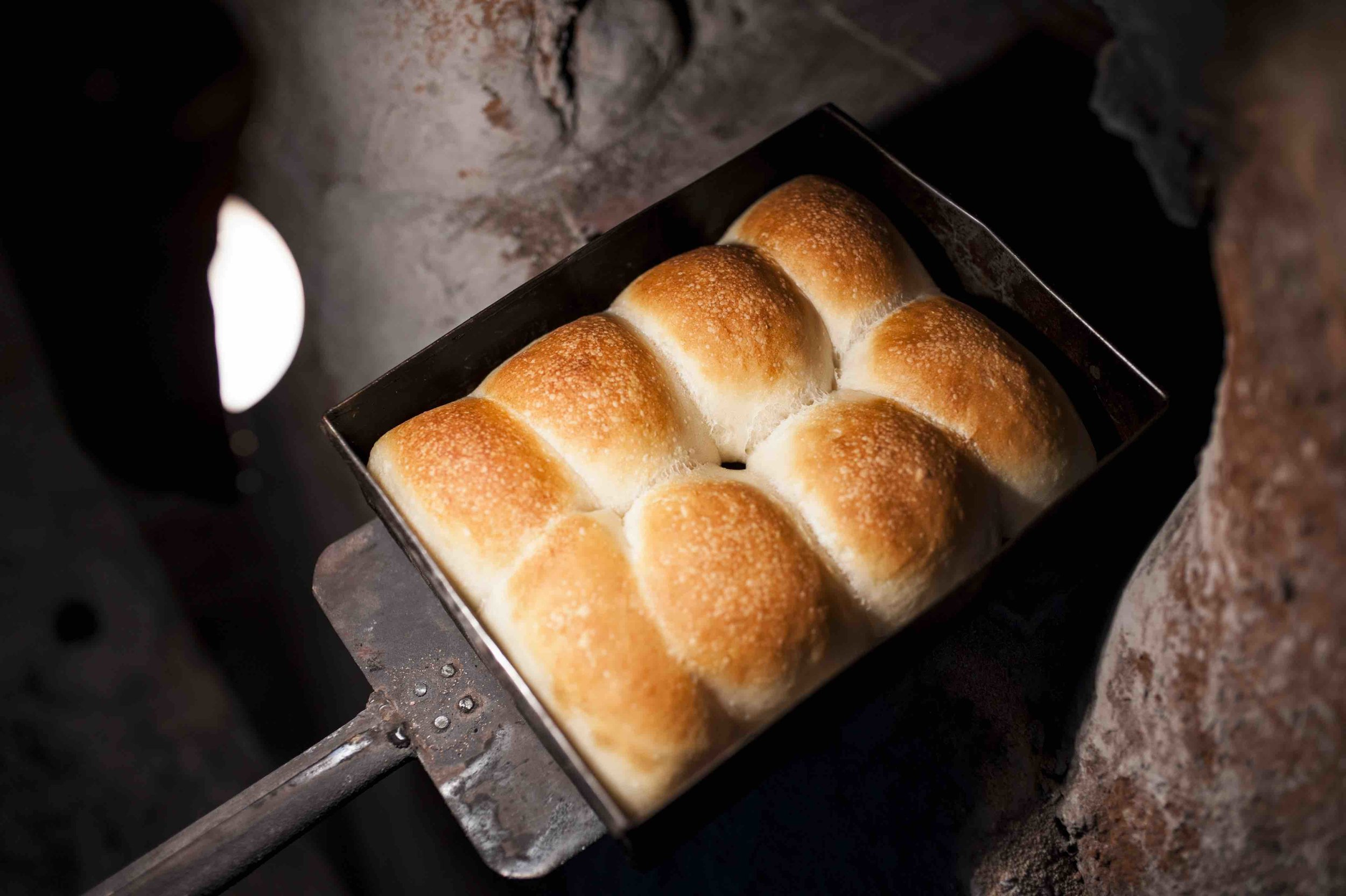 The bread is baked twice a day in the forn. Different breads need different temperatures to bake perfectly. The poie is baked first at the highest temperature, and then the katriche pao, regular pao and last to go in are kankana which are hard and crisp.  Shot in Anton Bakery, Colvale,2017