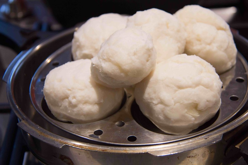 4. Boil water in a pressure cooker and oil an idli plate. Make balls of the rice mixture and place it in the idli plate. Cover pressure cooker and steam for 15 minutes.