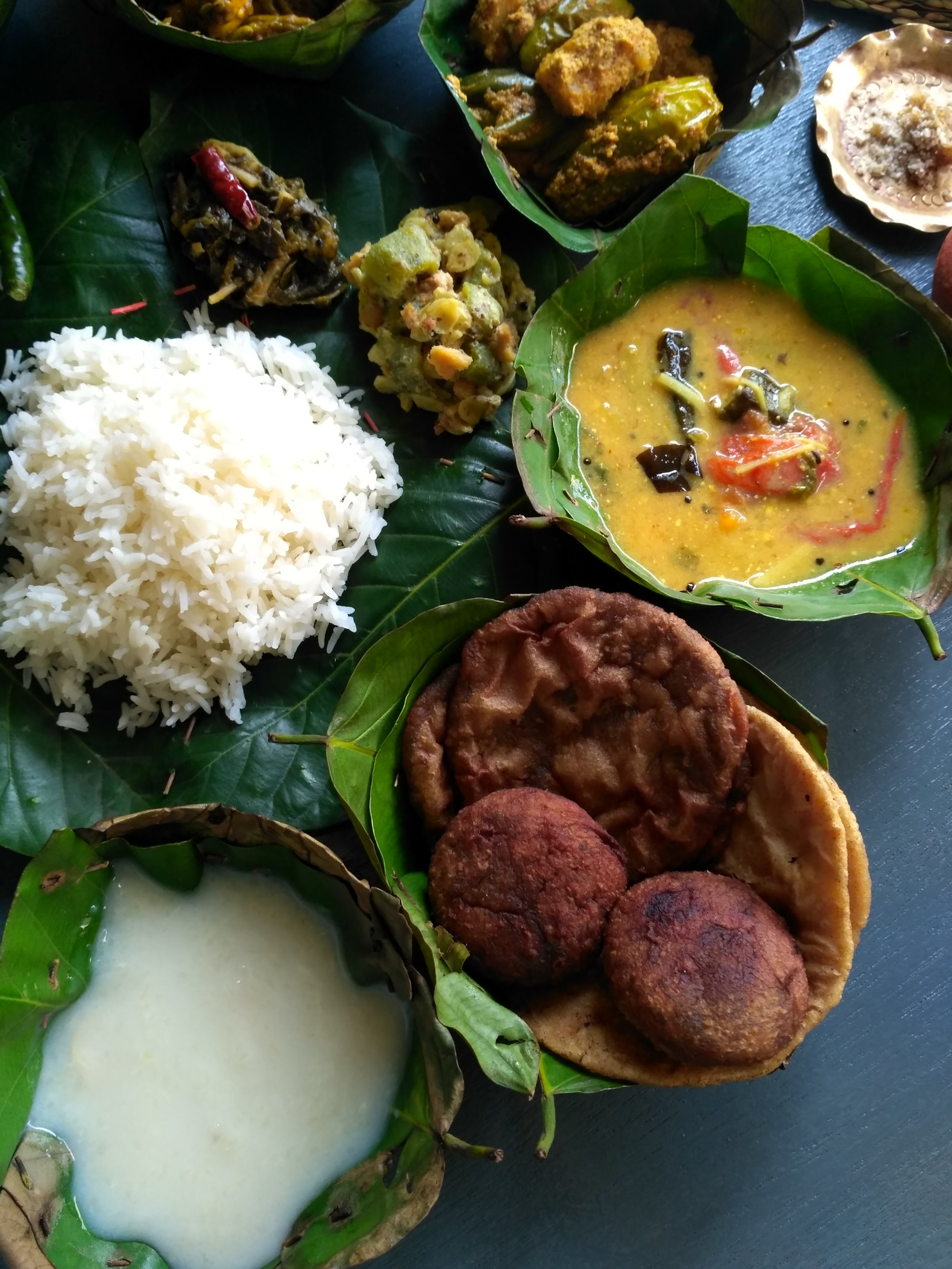 Western odisha's famous Nuakhai lunch where ambil is served with sun dried mango, bamboo shoots, curd and chickpea flour   Photo by A Treasure of Food.