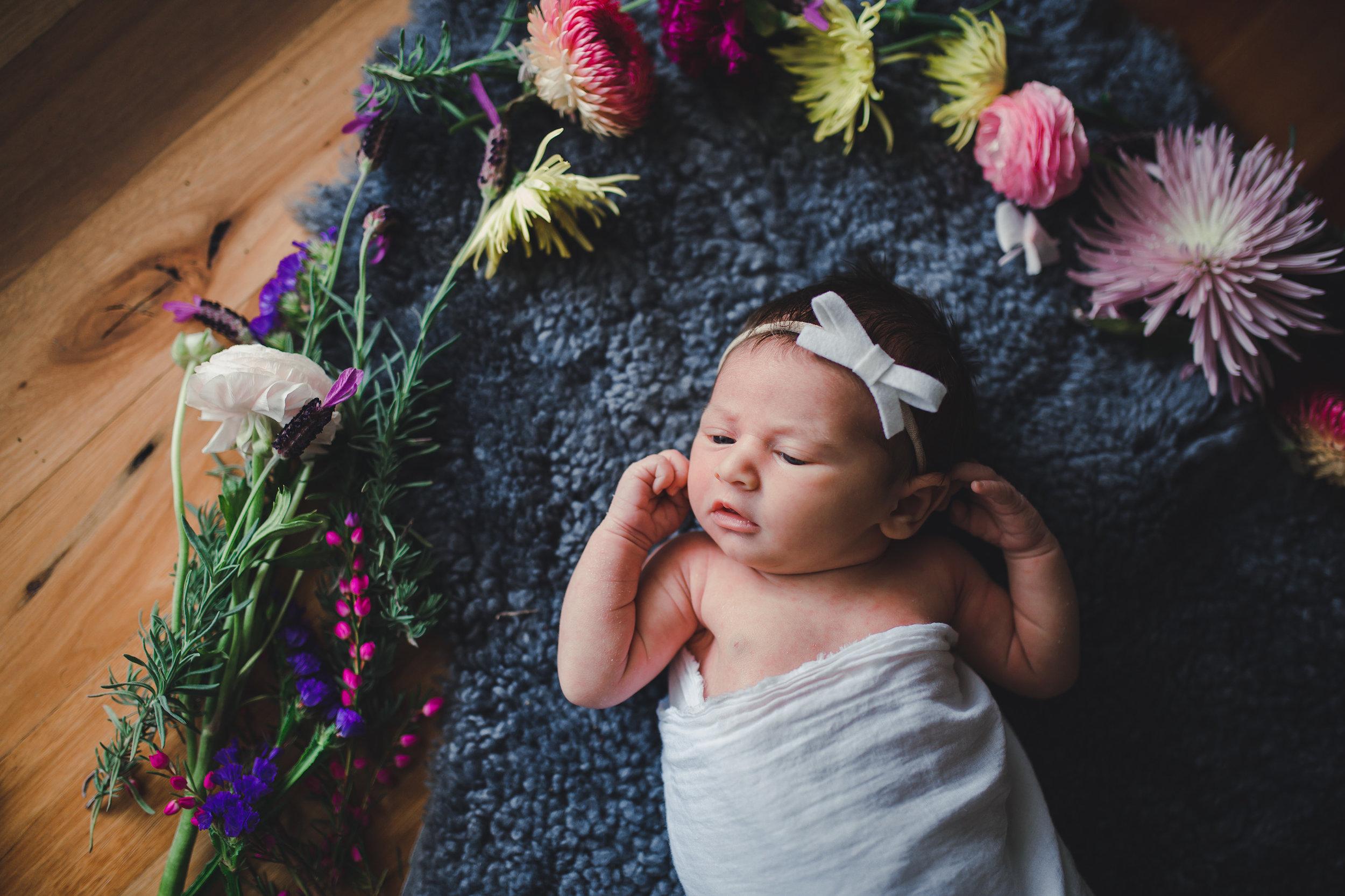 Newborn in flowers