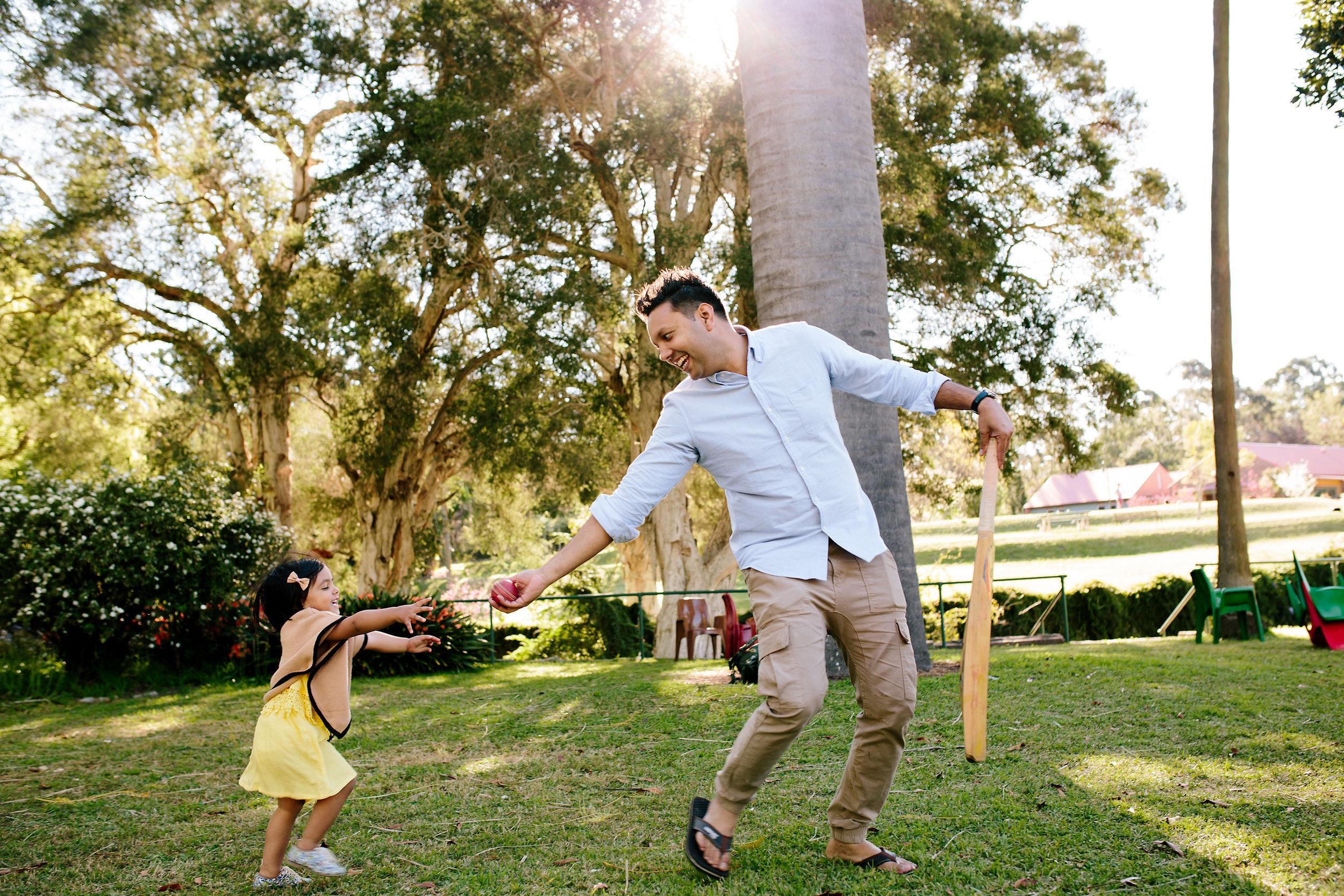 Dad teaching cricket