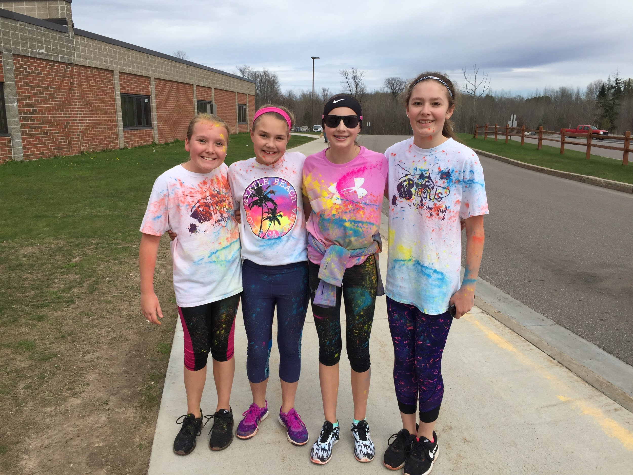 The District works with community groups focused on health. Here students participate in a mini-color run supported by the Ties that Bind Us.