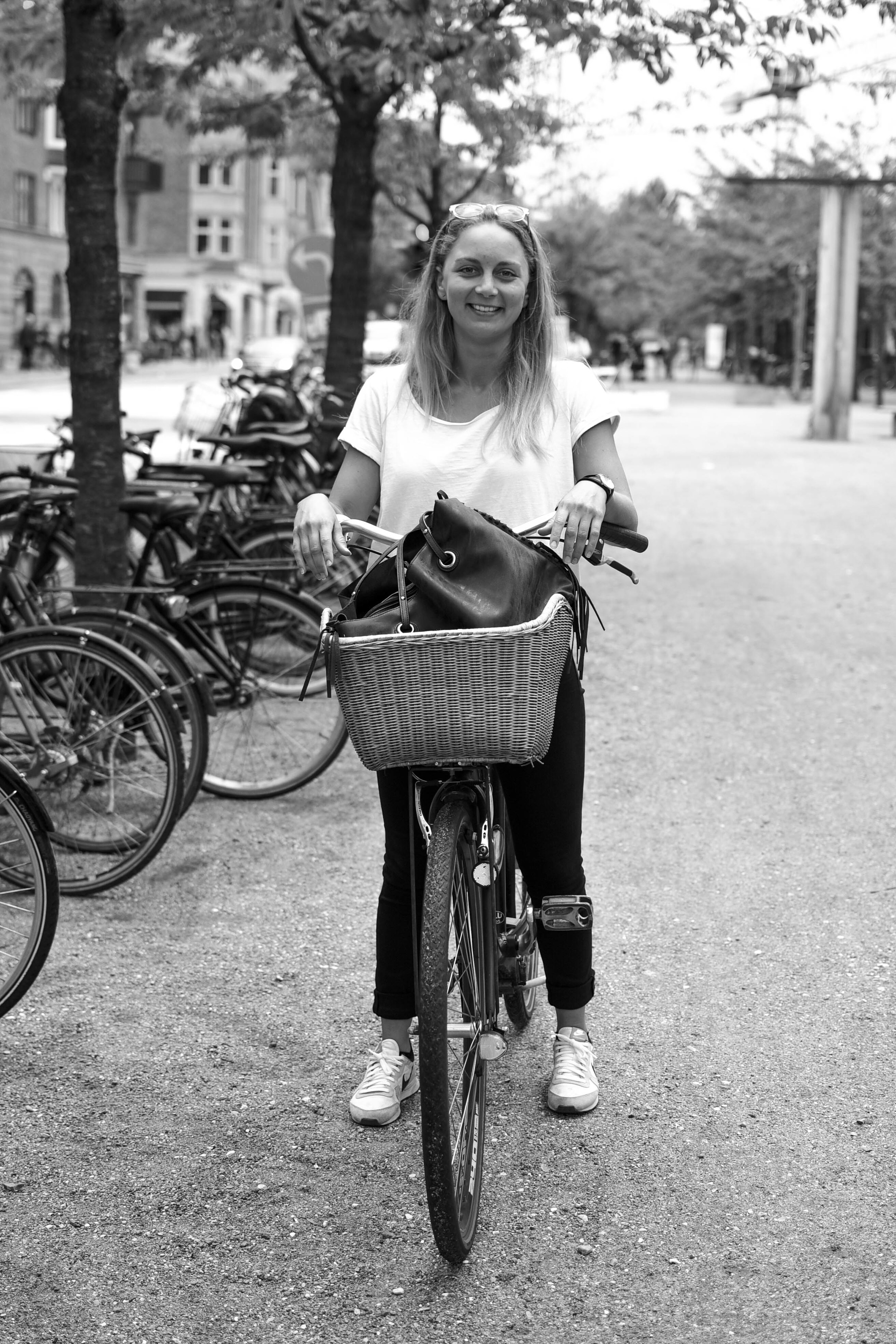 """""""I pretty much don't go anywhere without my bike!"""" ....Olivia hanging with her friends down by Islands Brygge."""