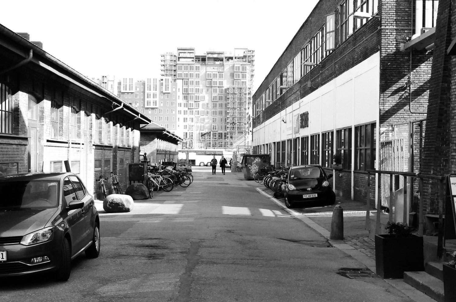 Old warehouses lining the streets of the Meatpacking District, looking south towards the modern harbour edge.