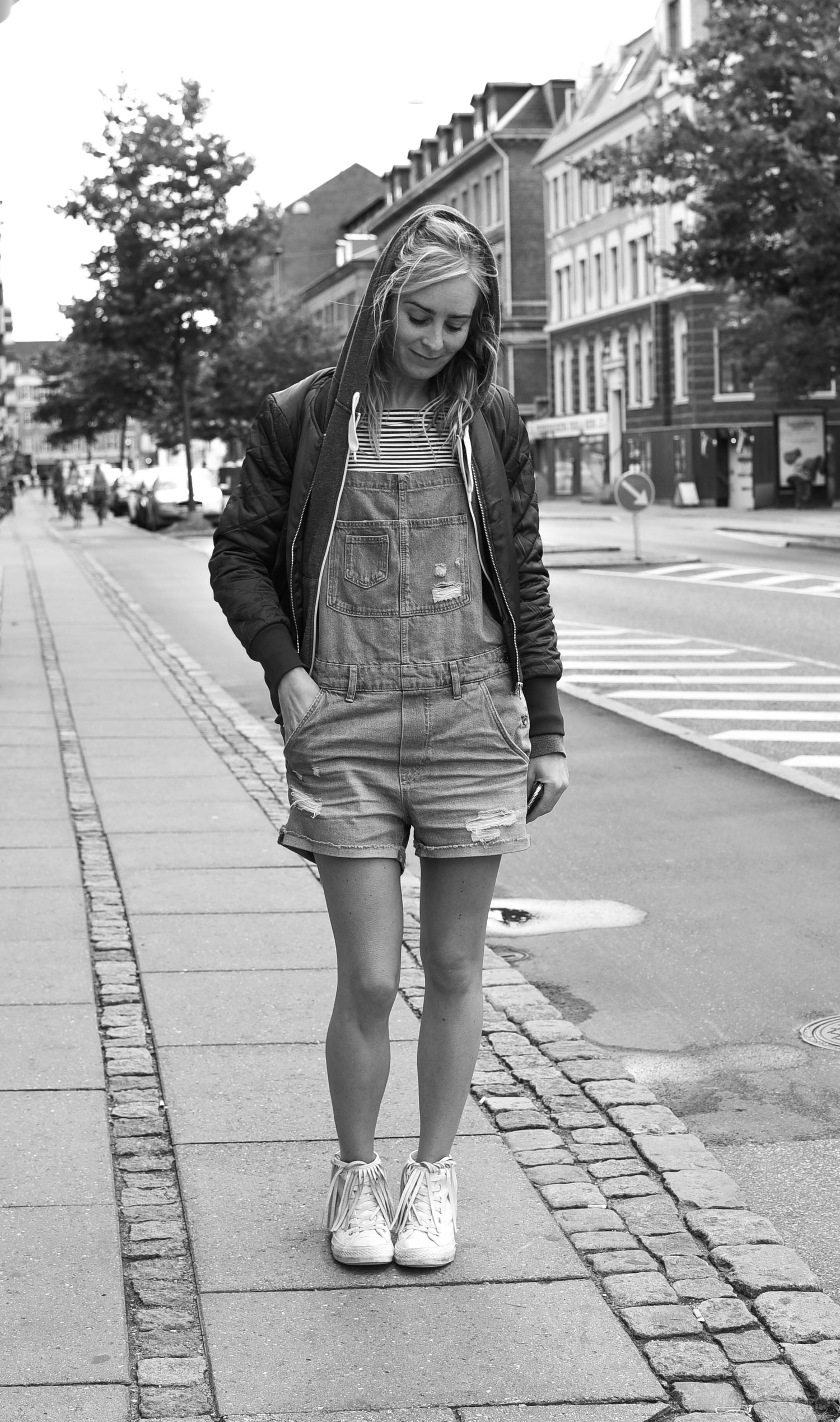 """""""Ahh I have a hangover!"""" ....Live J. plays the Cello by night and chills with friends in Norrebro by day .Casual hoodie, denim overalls and white sneakers...Copenhagen-style."""