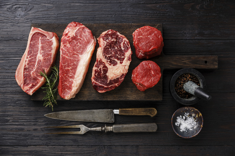 Variety of Raw Black Angus Prime meat steaks Blade on bone, Stri
