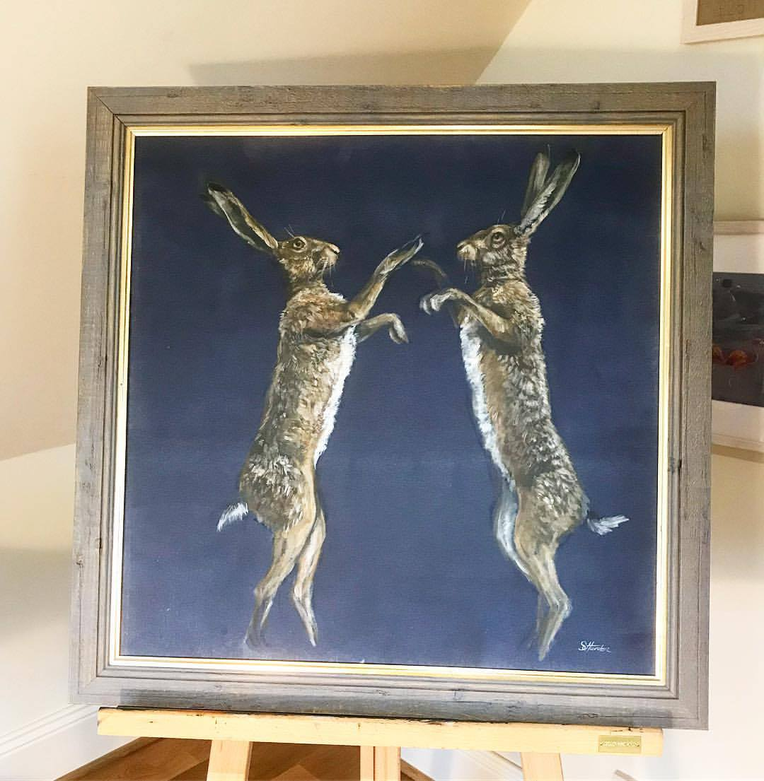 'Boxing Hares' Oil on canvas board. SOLD