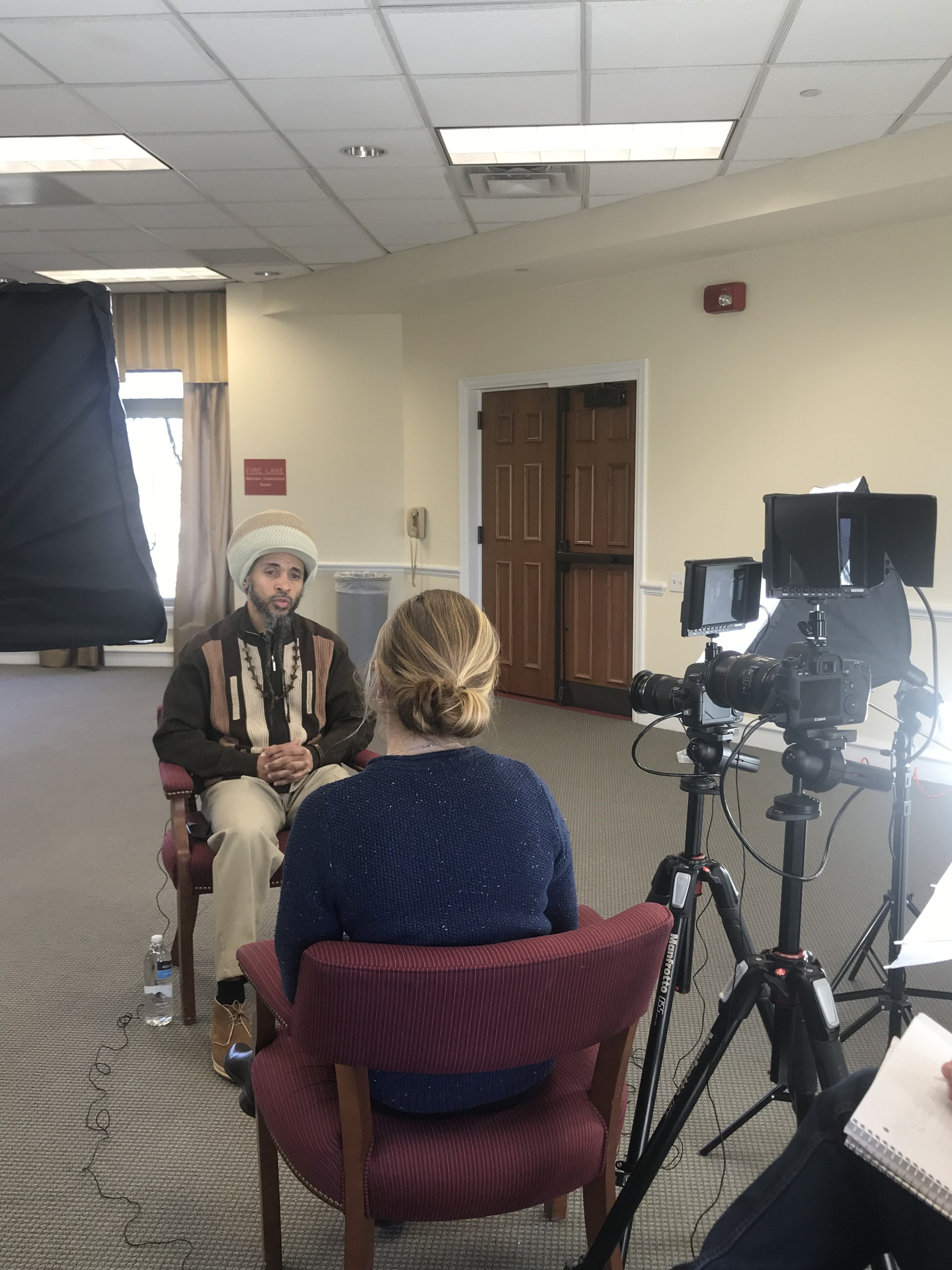 "Kempis ""Ghani"" Songster being interviewed by Megan Bevilacqua."