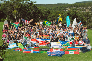 The whole conference together with their flags