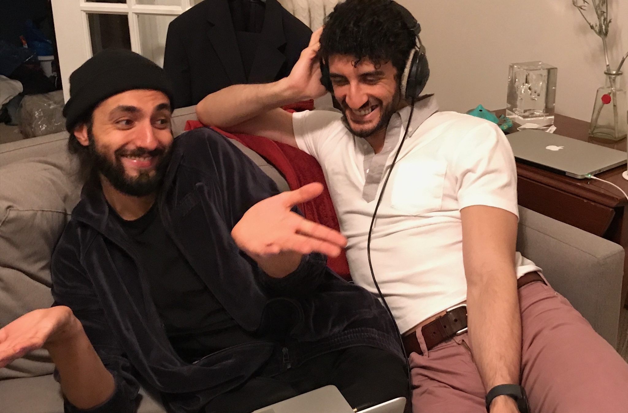 Qais and Ahmad listening to a track.