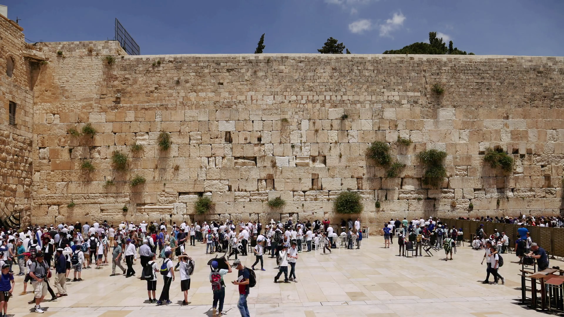 videoblocks-western-wall-or-wailing-wall-or-kotel-in-jerusalem-timelapse-plenty-of-people-come-to-pray-to-the-jerusalem-western-wall-the-wall-is-the-most-sacred-place-for-all-jews-on-the-planet_rvctjvrzw_thumbnail-full01.png