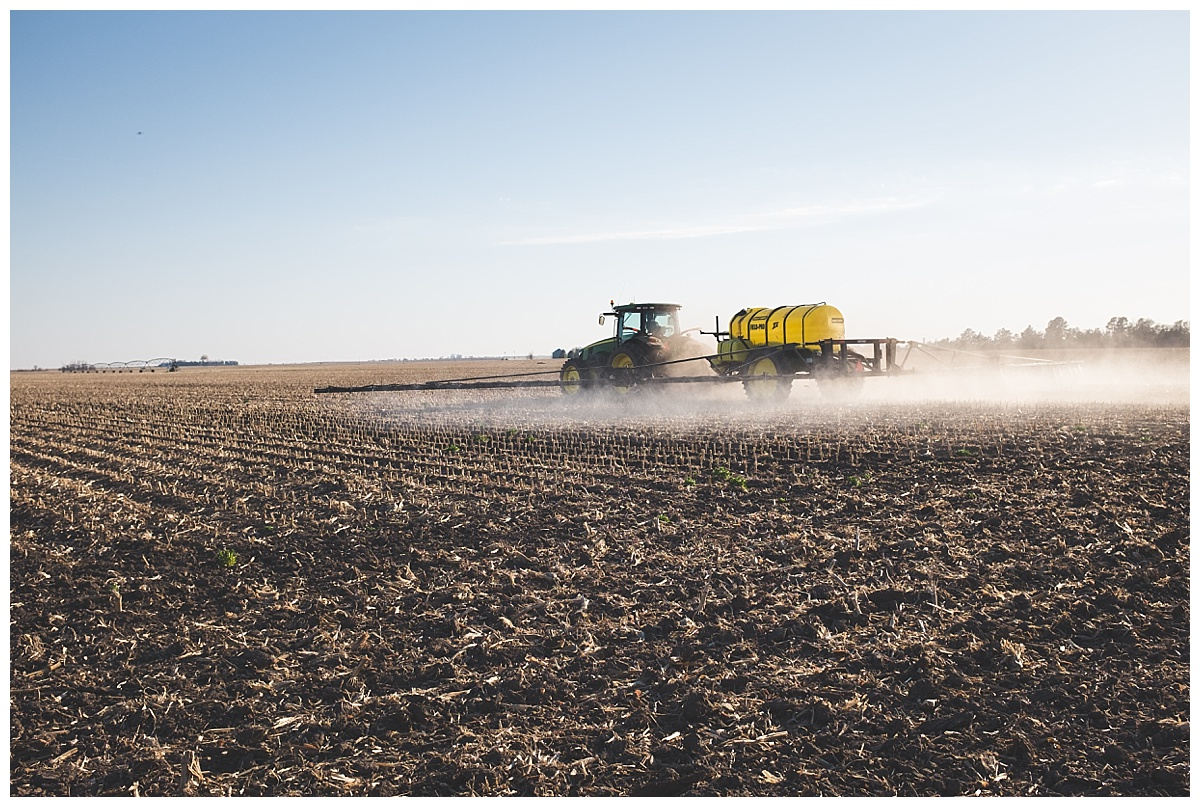 tractor spraying Nebraska corn field