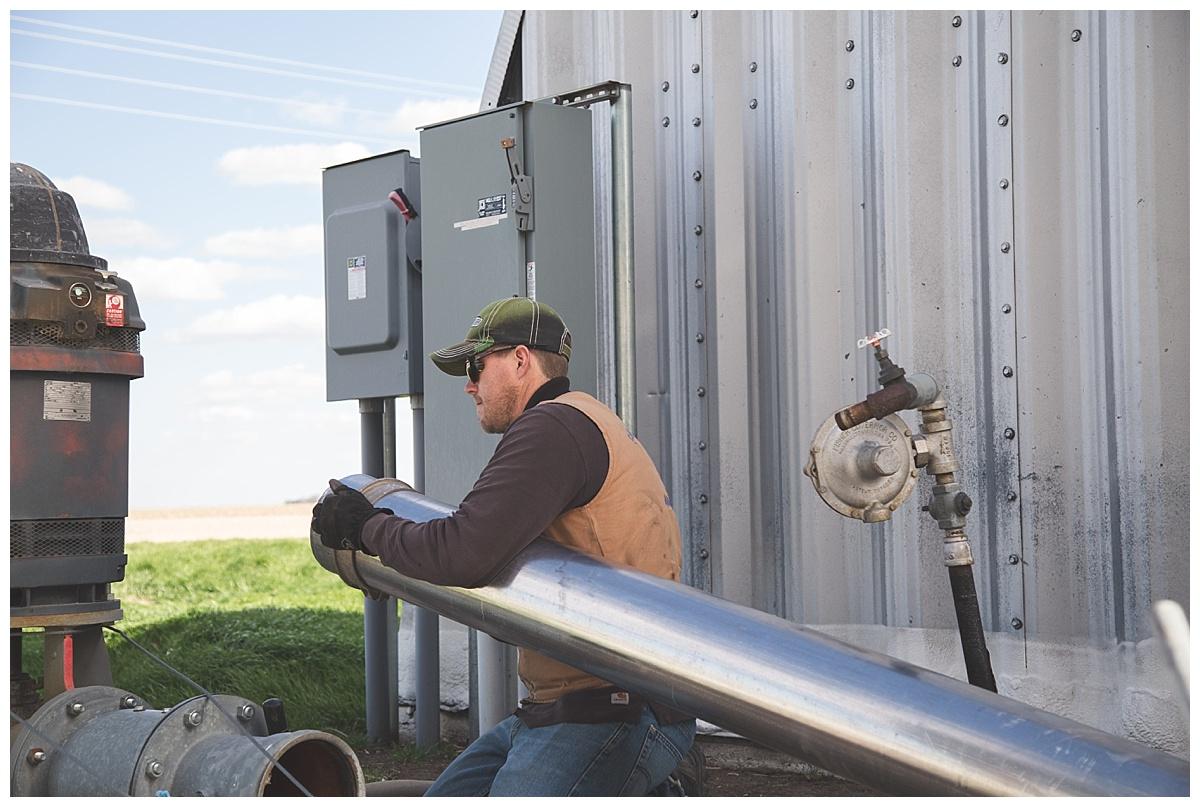 farmer installing water meters