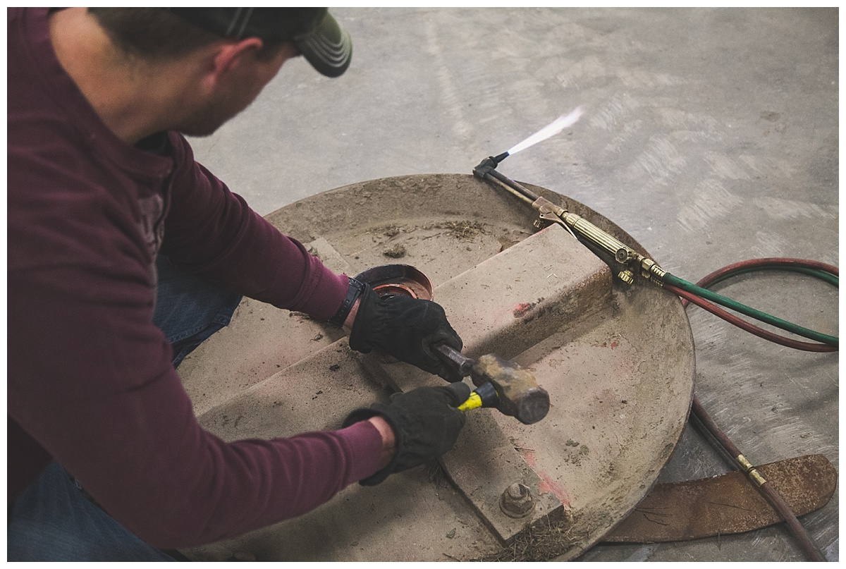 farmer working on shredder parts