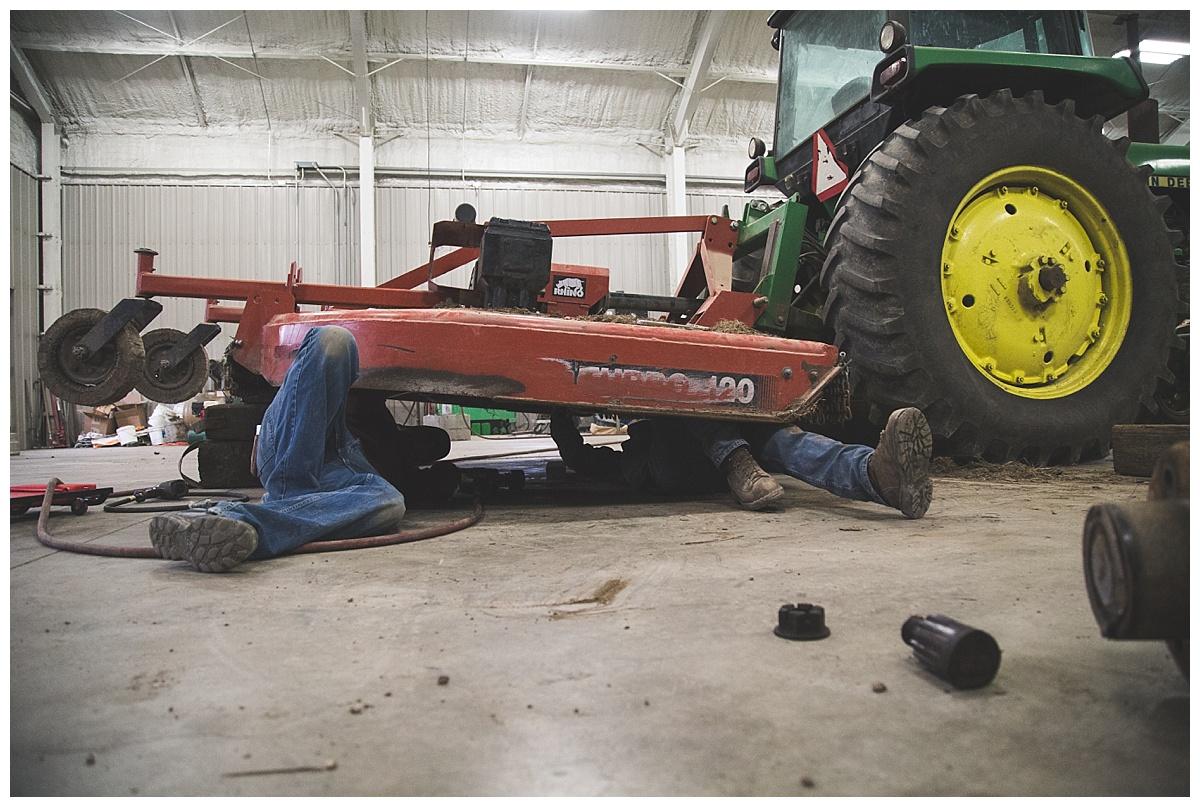 farmer working on shredder