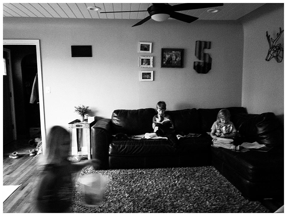 6:19 pm // Our typical after-supper scene: the older two reading and the youngest running around crazy.