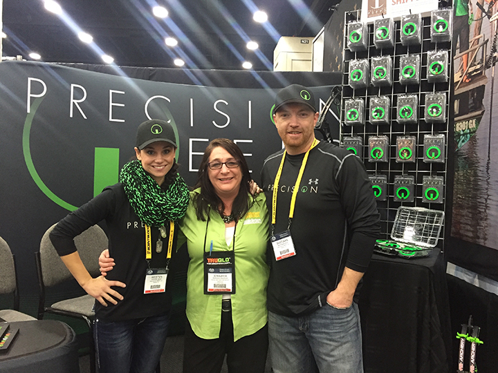 Inside Archery's Jennifer Krueger takes a photo with Kristen and Bastiaan Wolf (owners of Precision Peeps)at ATA 2016.