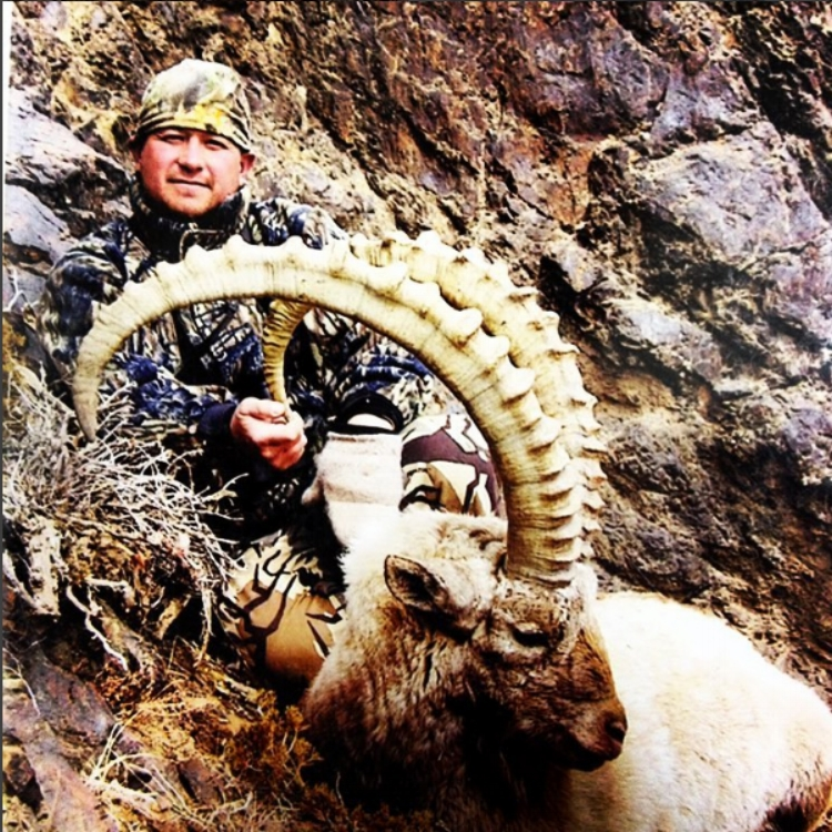 Mark Bonales with a Gobi Ibex he hunted in Mongolia