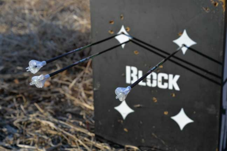 """Tony Petersen's practice session with a Precision Peep using a Block target. The caption reads: """"If you want tighter arrow groups without having to invest in high-cost equipment, consider an inexpensive peep-sight upgrade""""."""