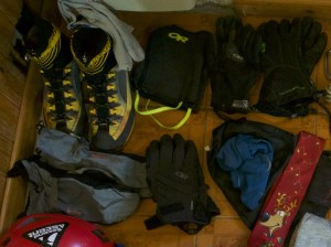 The sets of gloves I brought on Excocet. Ignore the other stuff in the photo, except the Christmas tie, that was another important piece of kit. The blue mitten shells are on the left.