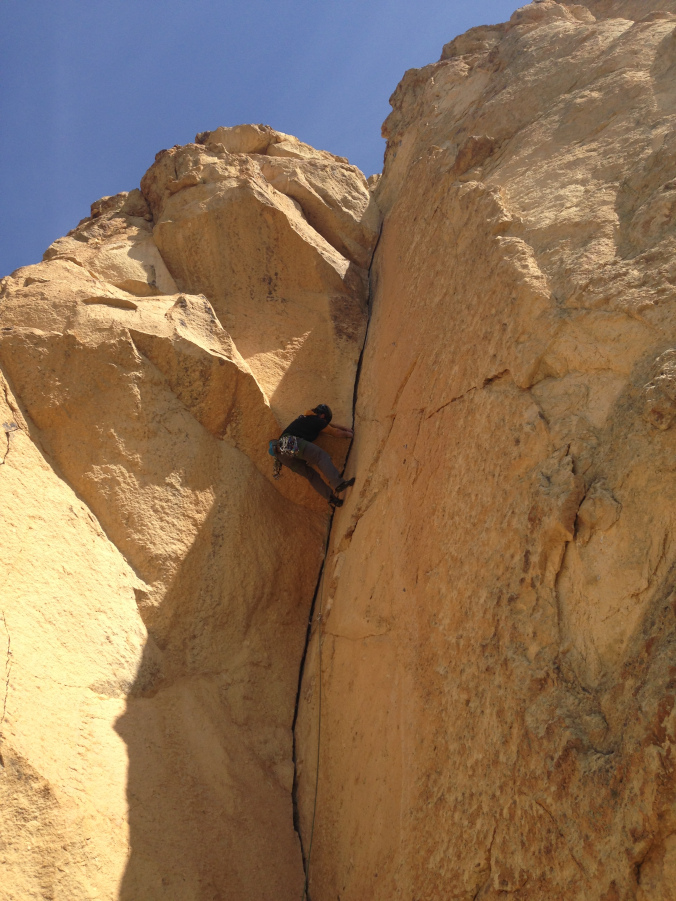 Excellent crack technique on the crux of Delirium Tremens at Smith Rock. Photo: Vinny Stowell