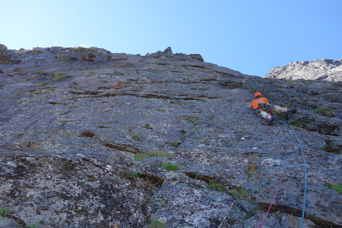 JIMMY LEADING THE FIRST 5.10 PITCH ON THE EAST PILLAR OF SLESSE