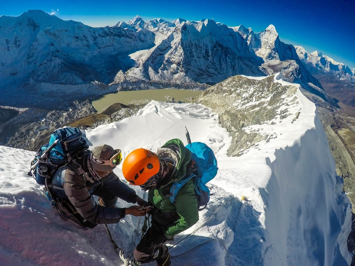 Nigma Sherpa and Phurba Sherpa just below the summit of Imja Tse setting up their rappels. (Photo credit: Ida Vincent)