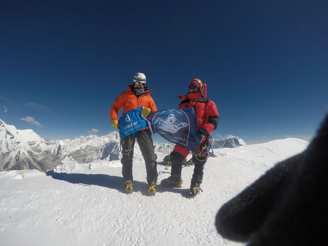 Kim and Phurba on the summit of Ama Dablam. (Photo credit: Kim Couri).