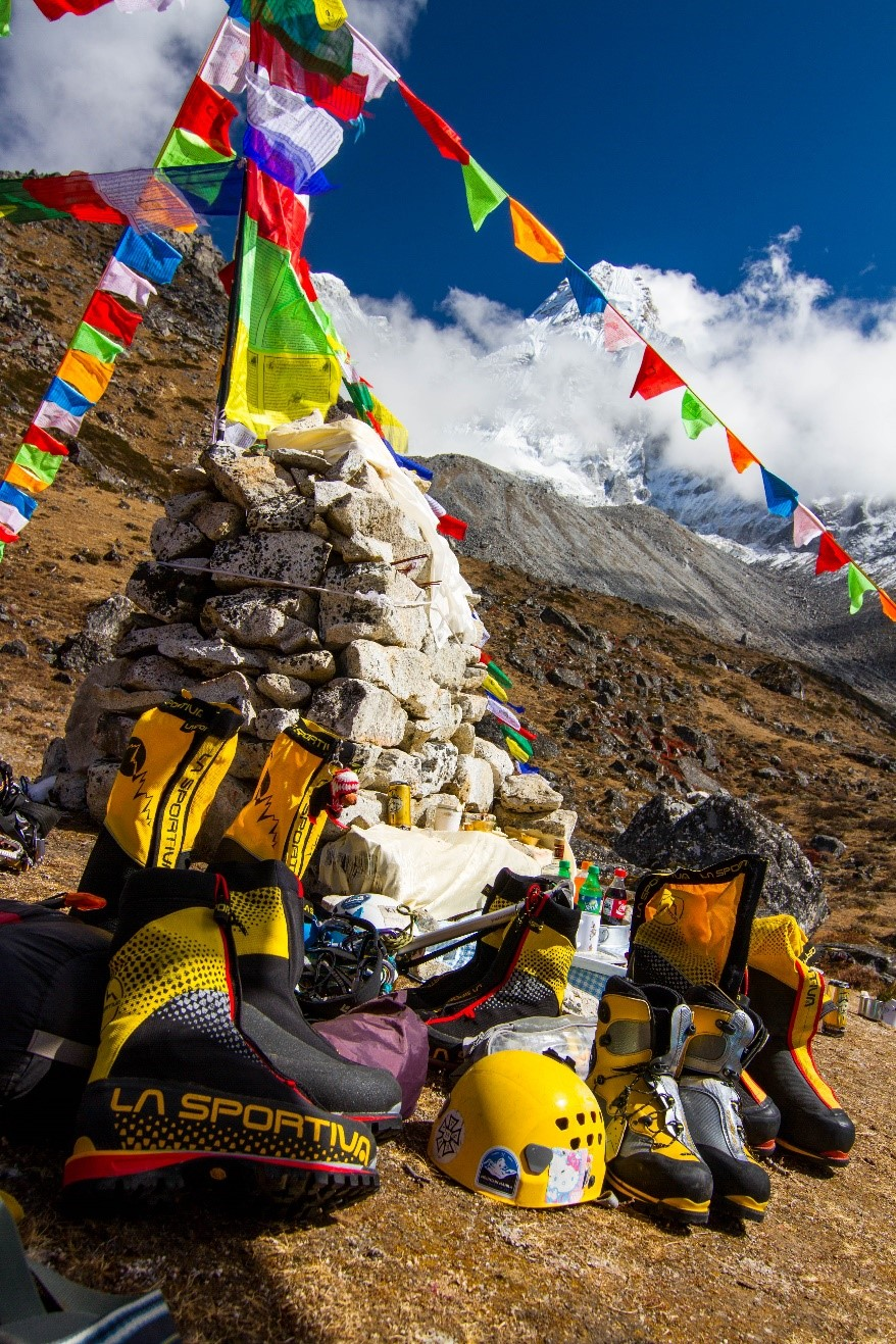 Our La Sportiva boots being blessed in a Puja (ceremony) for the Mountain Gods before starting to climb.