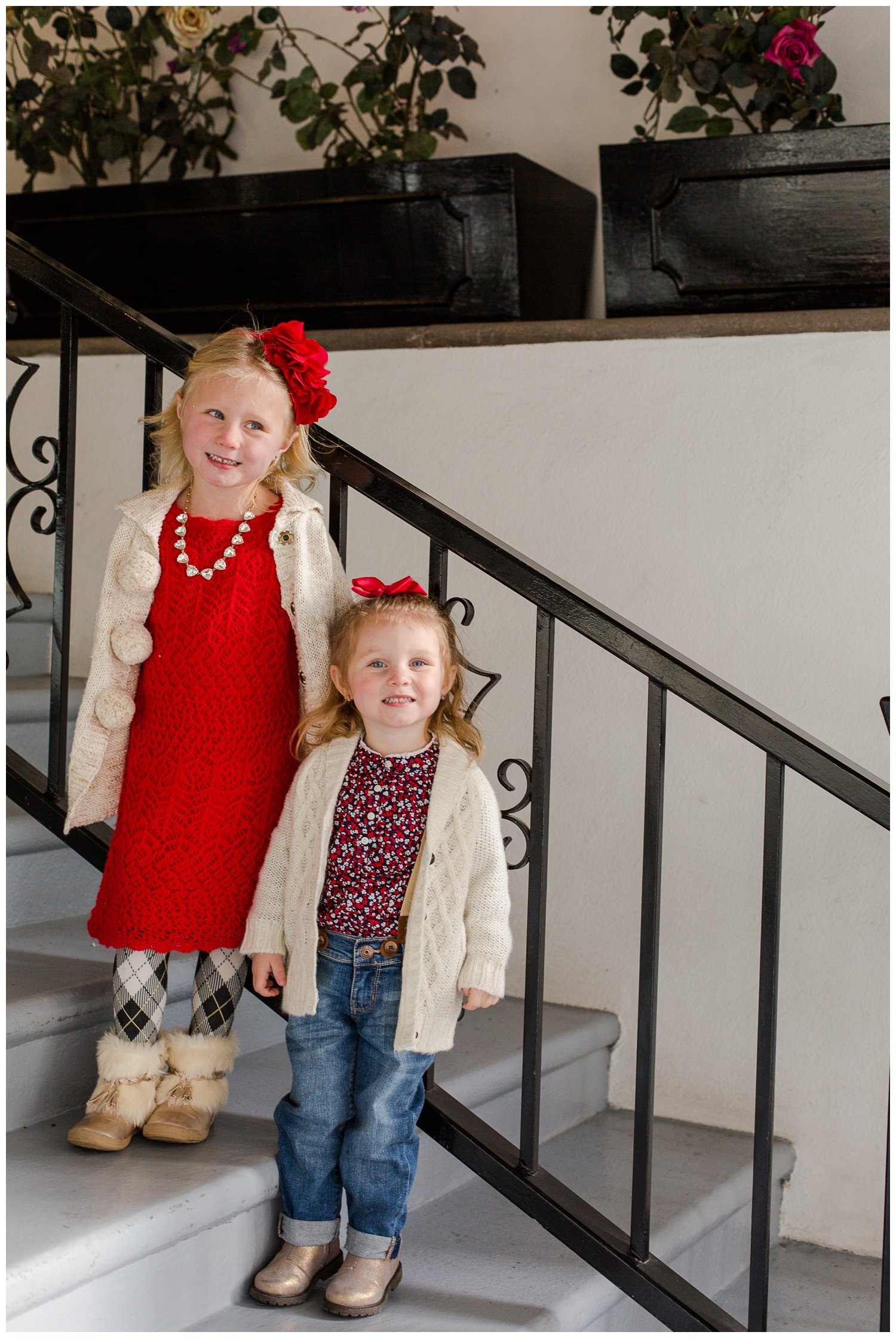 These sisters are perfectly coordinated and cozy warm! We took these images in downtown Reno on a chilly day! They had the perfect shoes on for keeping their feet warm and walking around town and their cardigans were fashionable and cozy so that we had happy smiles through the session.