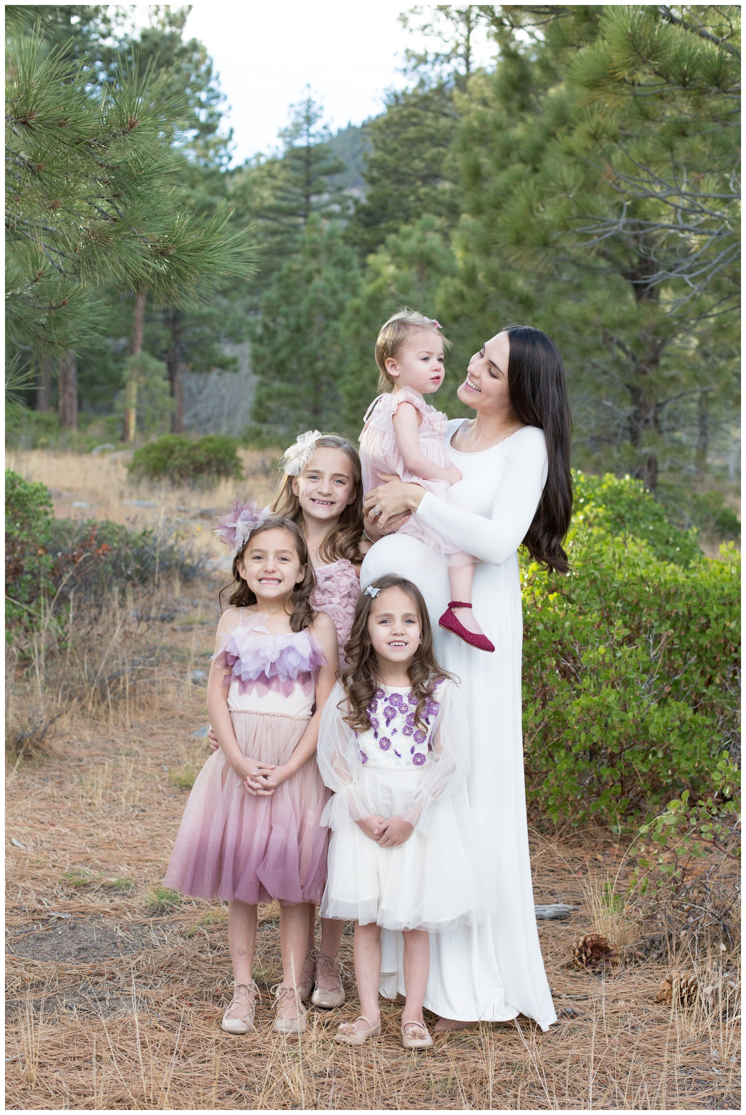 I love how these dresses rented from Rainey's Closet coordinate rather than all of them being in the exact same dress! It allows for each girl to show their own personality!