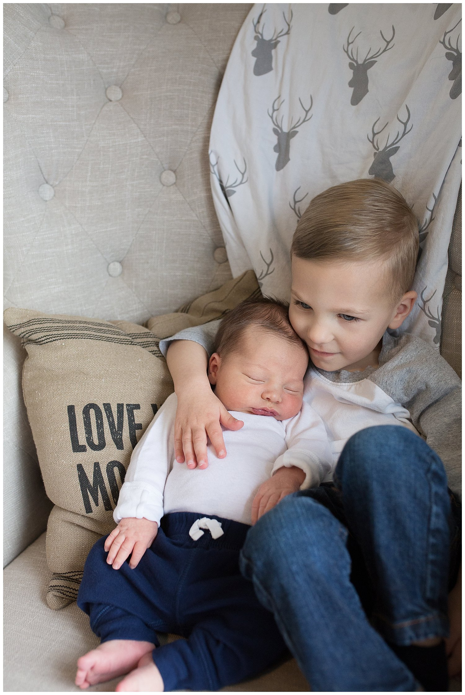 brother cuddling newborn brother photography