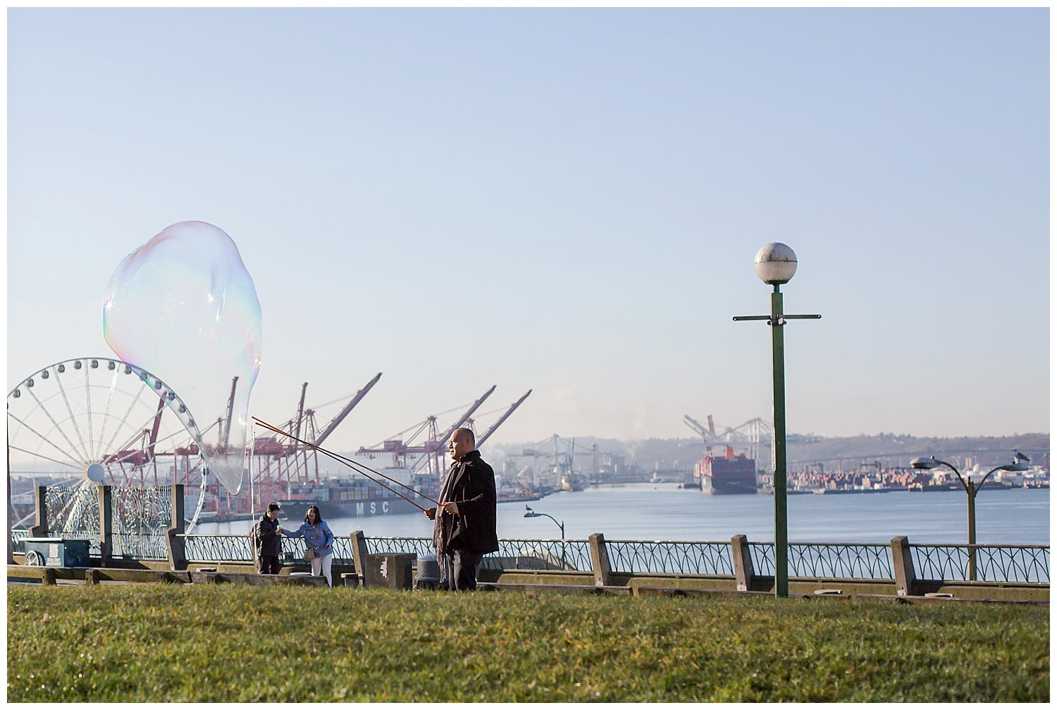 Bubble art in Seattle Washington with the Great Wheel in the background