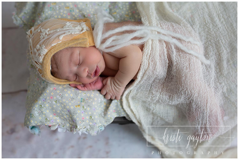 newbornbabygirlyellowbonnetrenonewbornphotography
