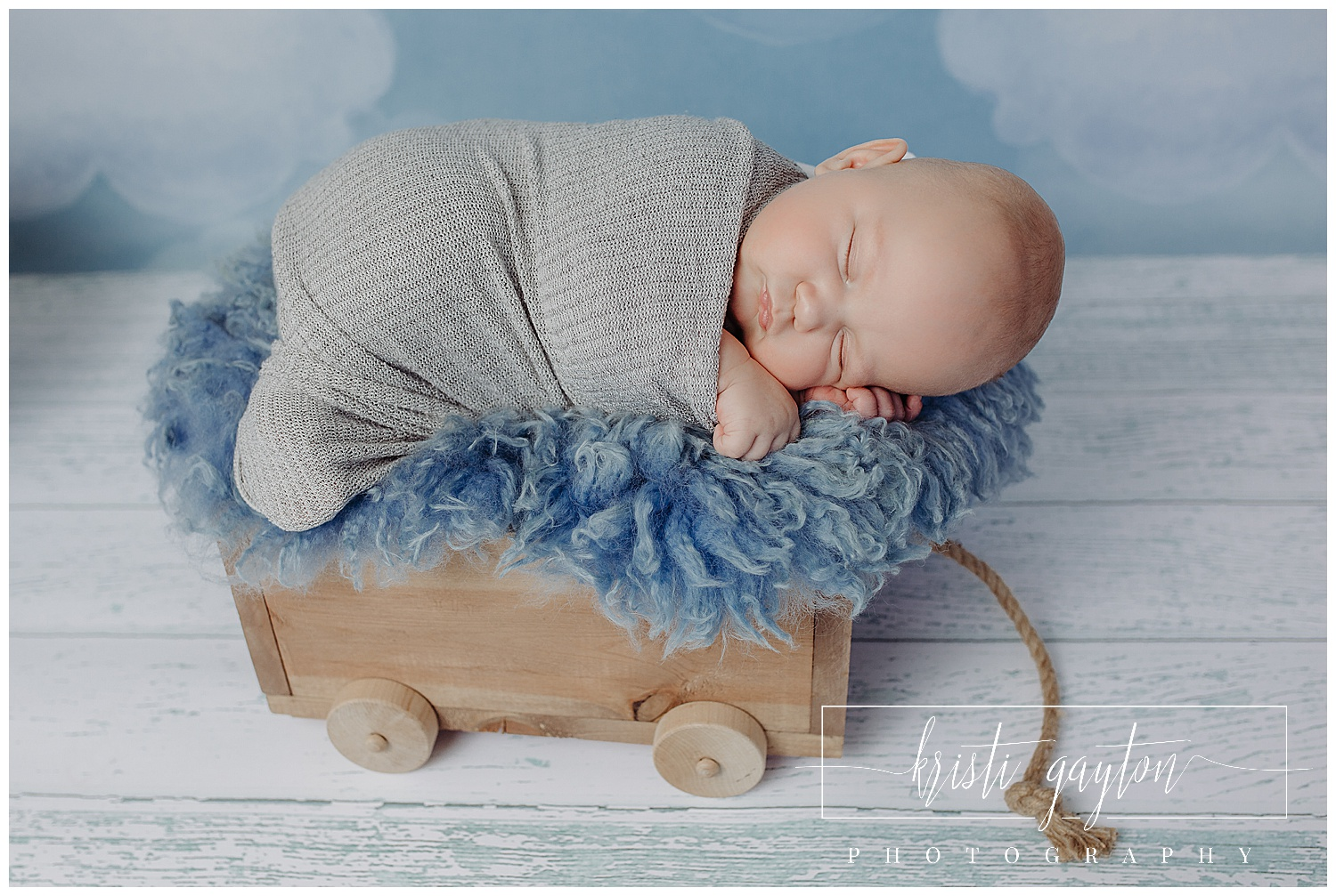 newborn baby in wagon