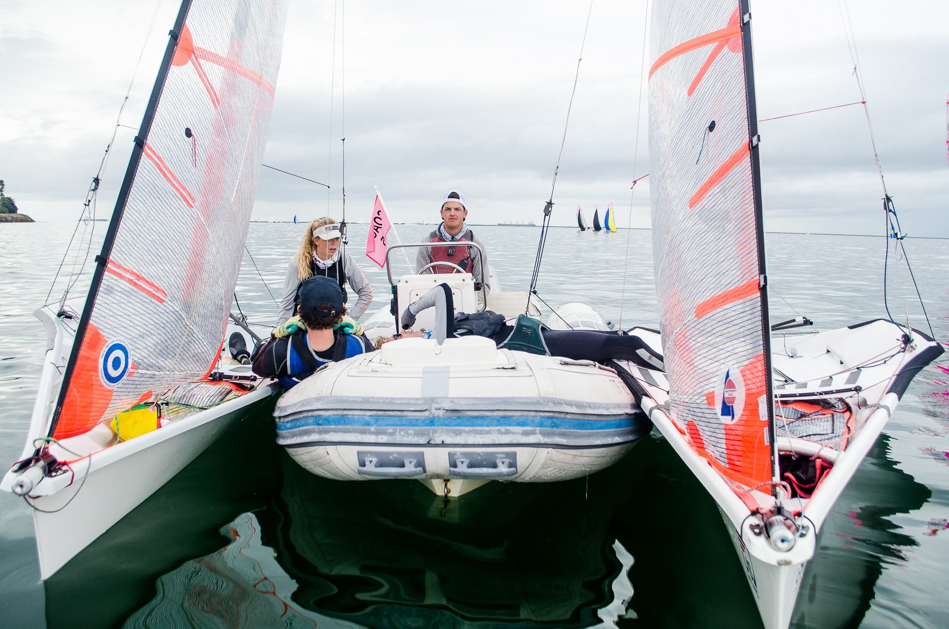 29er sailboats winged up on the coach boat with Coach Evan Heffernan