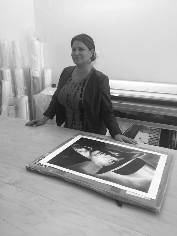 Karen Gravano with her father's original artwork