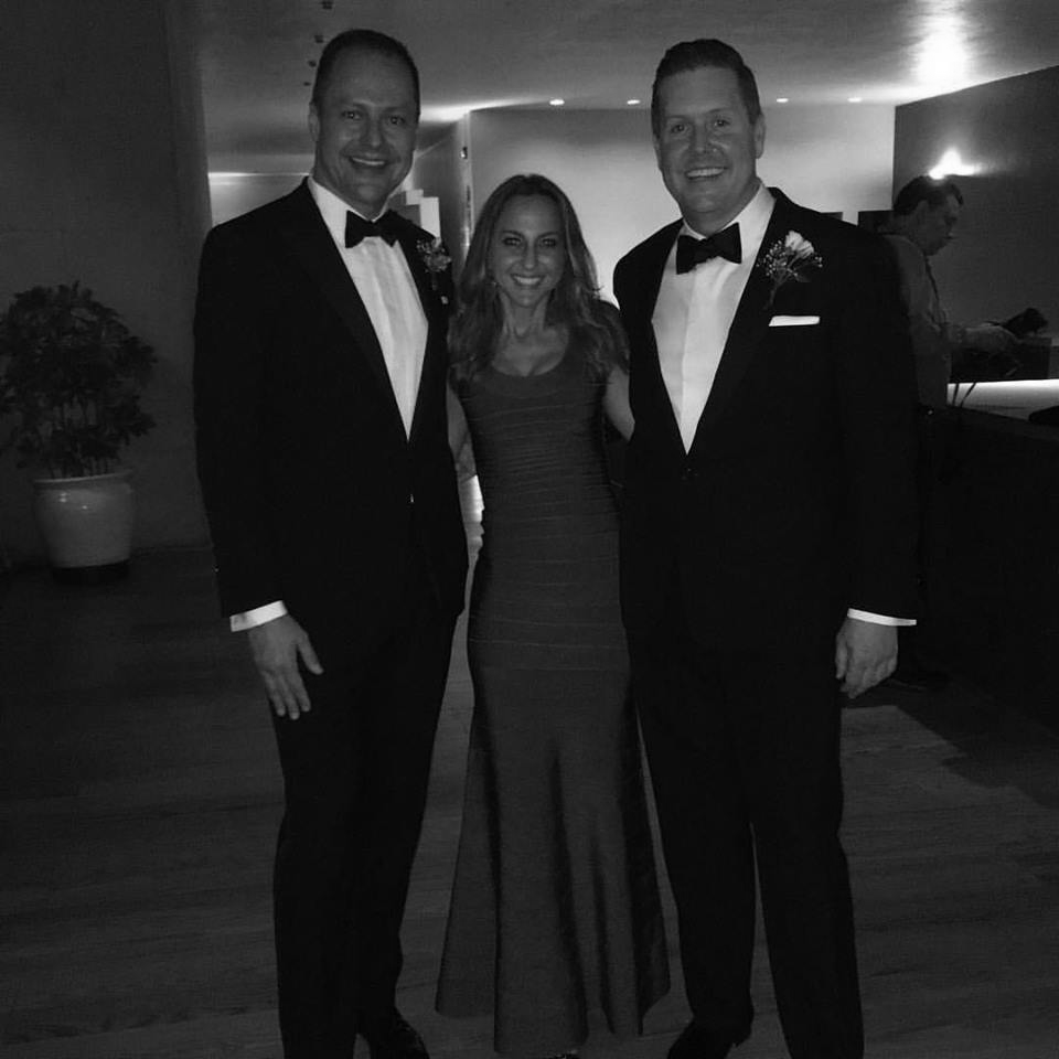 Lady in red (well...yes, the photo is in black and white). Carmita pictured with bestie, Chad Ellsworth (right, also a partner at Fragomen) and his husband, David