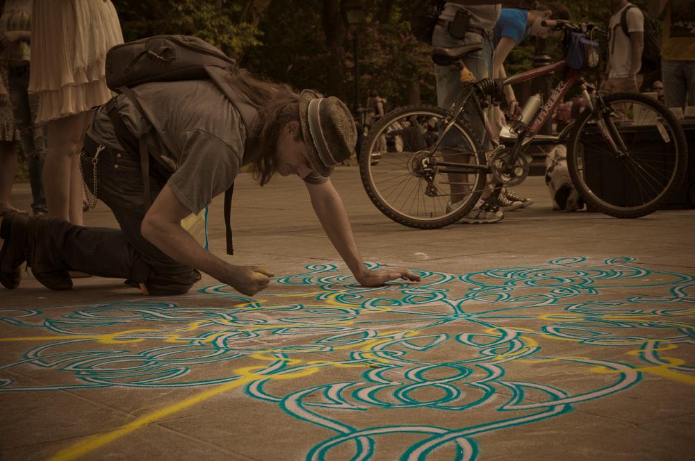 """Joe Mangrum, NYC Sand Artist""by Camile Grace"