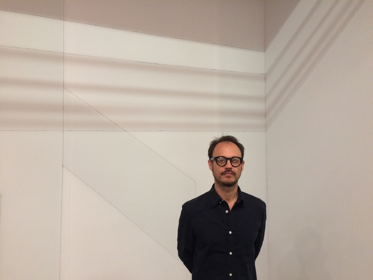 Francisco Ugarte infront of his linear shadow installation , Arrendondo Arozarena, Mexico City