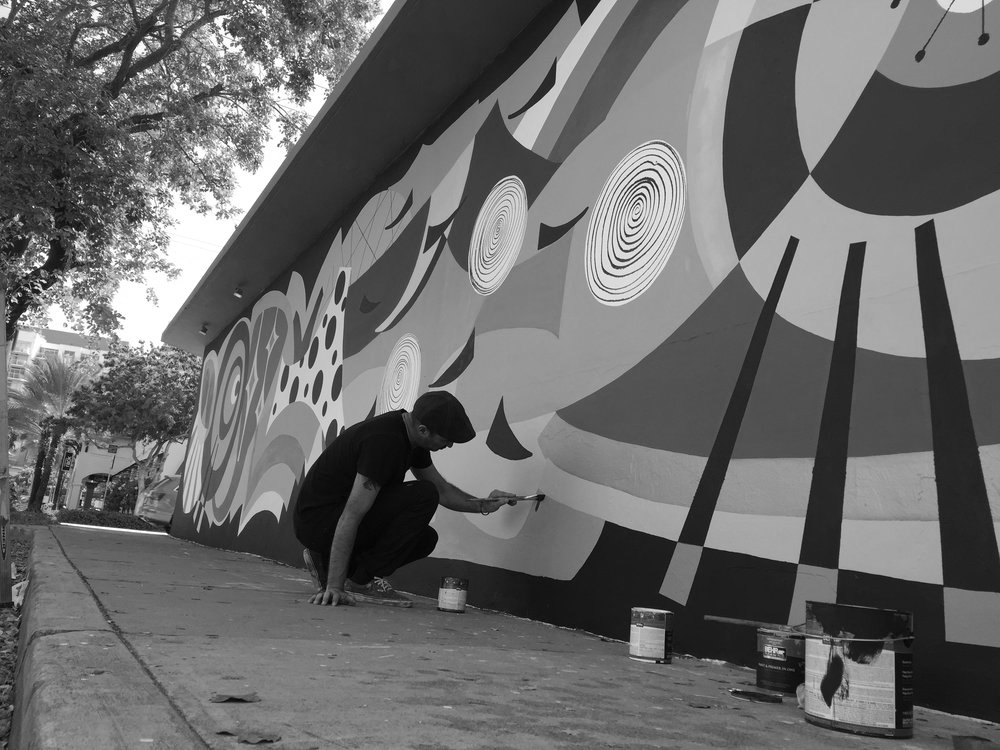 Artist Amauri Torezan painting a commissioned mural in Wynwood, Miami