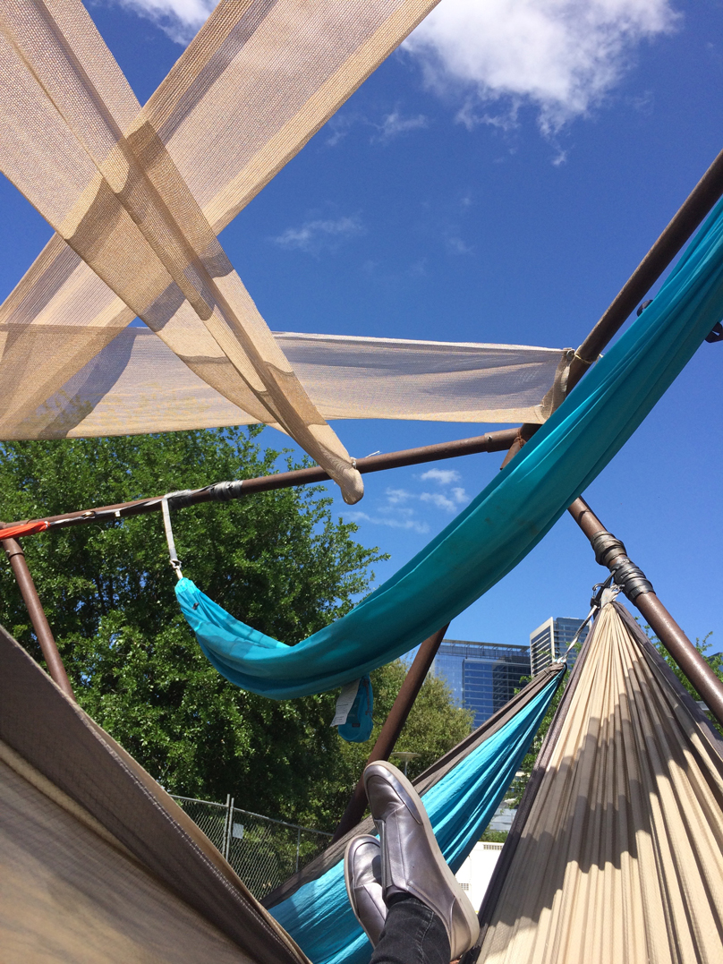 Lounging in one of the hammocks provided on the Art City Austin festival grounds