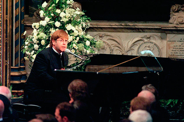 Elton John performing at Princess Diana's funeral in Westminster Abbey.  Image from Billboard