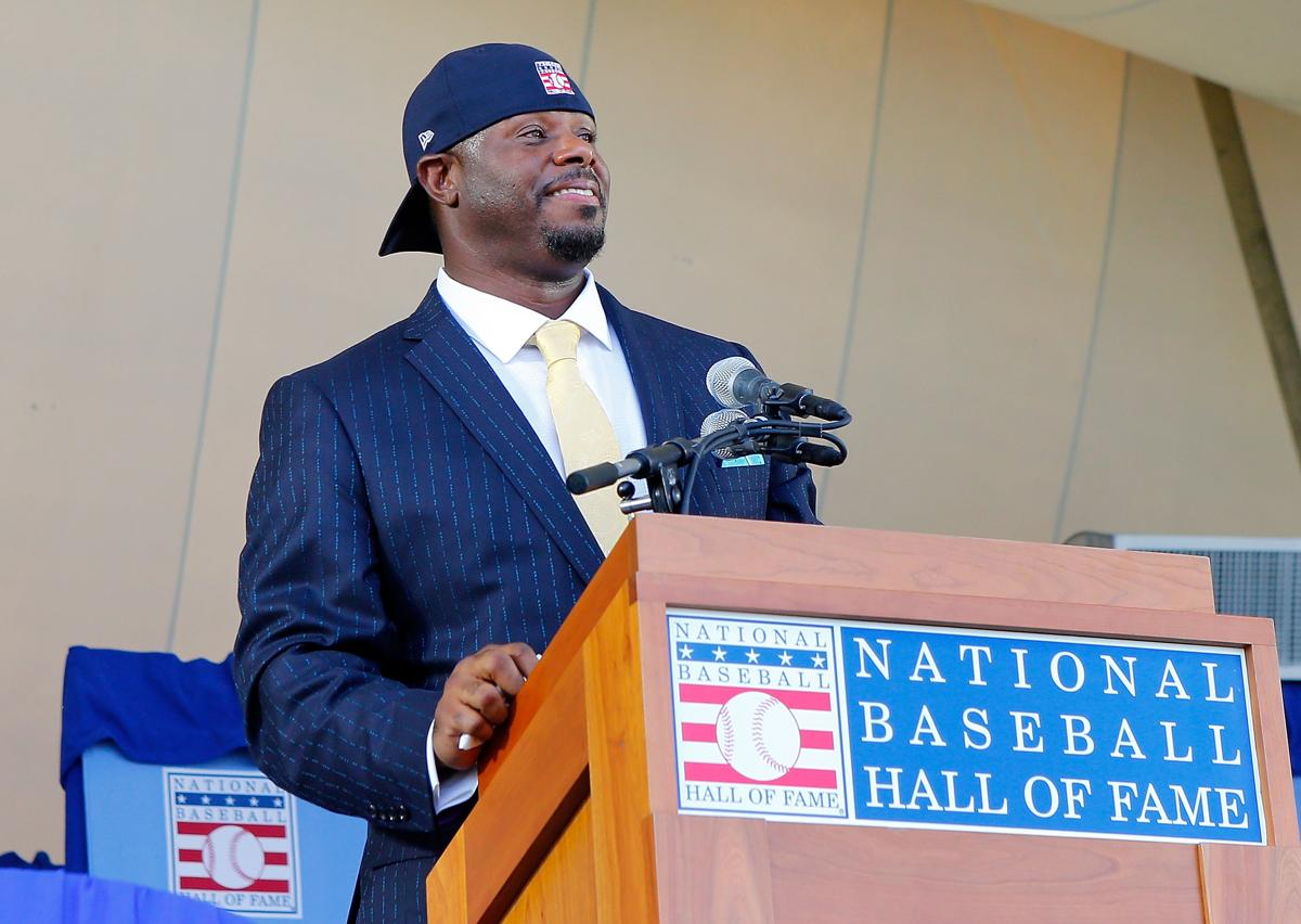 Junior ended his speech by pulling out a Hall of Fame hat and putting it on backwards in classic Griffey style.  Photo from Boston Globe